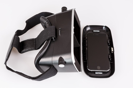 simulator: virtual reality simulator glasses for smartphone on white, vr experience Stock Photo