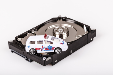 ambulance car on harddrive or hdd - data backup, safe and rescue concept Stock Photo