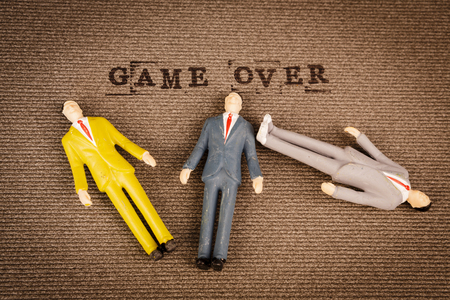 text game over with human bodies of mans and womans - death concept Stock Photo