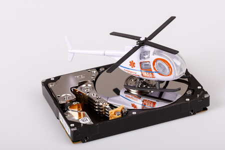 ambulance helicopter or chopper on harddrive or hdd - data backup, safe and rescue concept