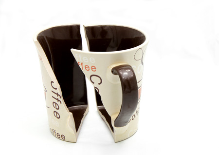 Isolated broken coffee cup photo