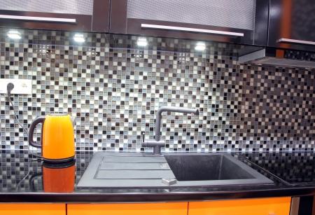 mosaic floor: Modern black and orange kitchen Stock Photo