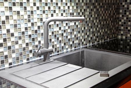 Modern black and orange kitchen Stock Photo