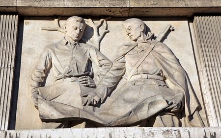 ruzomberok: RUZOMBEROK, SLOVAKIA - MARCH 2: Old communist relief on the facade of the school building on March 2, 2014 in Ruzomberok