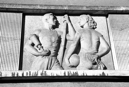 RUZOMBEROK, SLOVAKIA - MARCH 2: Old communist relief on the facade of the school building on March 2, 2014 in Ruzomberok Stock Photo - 26434960