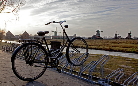 Windmills and bike in Zaanse Schans museum, Netherlands