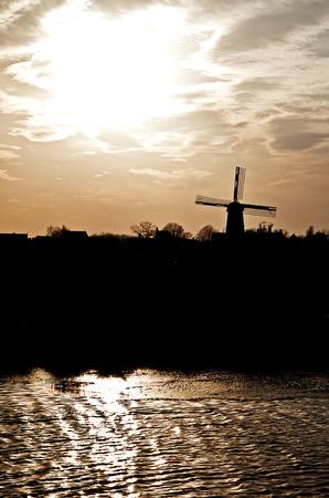 sulight: Windmills in Zaanse Schans museum, Netherlands Stock Photo