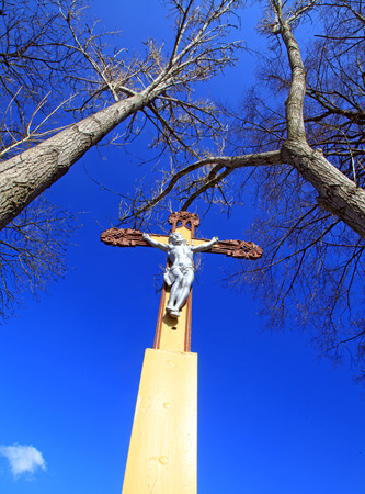 nailed: Jesus Christ on the cross and blue sky Stock Photo