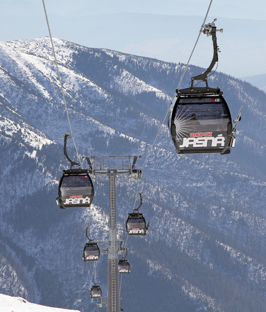 slovak republic: JASNA, SLOVAKIA - MARCH 13: Modern cableway in ski resort Jasna - Low Tatras mountains on March 13, 2014 in Jasna Editorial
