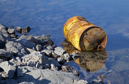 water contamination: Oil barrel on water basin Liptovska Mara, Slovakia