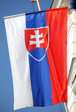 Slovak national flag on a mast photo