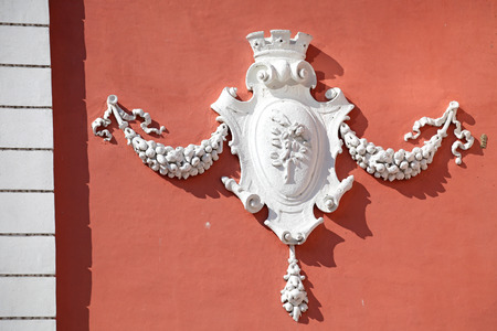 relievo: RUZOMBEROK, SLOVAKIA - MARCH 29: Relief on the facade of town hall on March 29, 2014 in Ruzomberok Stock Photo