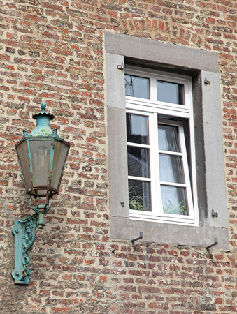 dweling: Old lamp at the building - Aachen, Germany