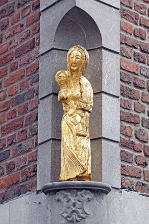 dweling: Old statue at the building - Aachen, Germany Stock Photo