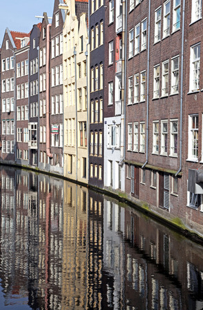 Water canal and typical architecture in city Amsterdam on April 3, 2014 in Amsterdam photo