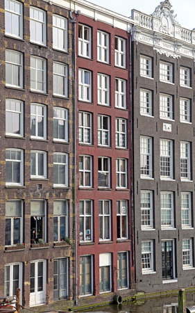 dweling: Water canal and typical architecture in city Amsterdam on April 3, 2014 in Amsterdam