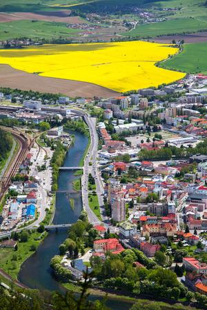 rapaseed: RUZOMBEROK, SLOVAKIA - MAY 10: Town Ruzomberok from hill Cebrat on May 10, 2014 in Ruzomberok