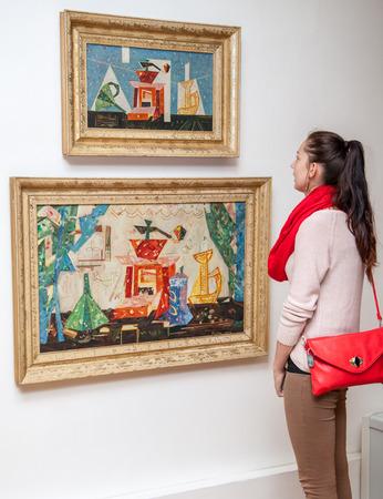 ruzomberok: RUZOMBEROK, SLOVAKIA - JULY 22: Girl looking at Fullas painting in Gallery of Ludovit Fulla on July 22, 2014 in Ruzomberok Editorial
