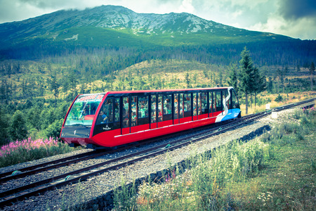 stary: STARY SMOKOVEC, SLOVAKIA - JULY 26: Funicular at High Tatras mountains on July 26, 2014 in Stary Smokovec Editorial