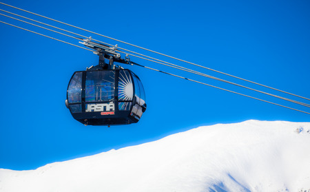 moderm: JASNA, SLOVAKIA - FEBRUARY 18: Modern cableway FUNITEL in ski resort Jasna - Low Tatras mountains on February 18, 2015 in Jasna