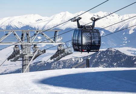 moderm: JASNA, SLOVAKIA - FEBRUARY 18: Modern cableway FUNITEL in ski resort Jasna - Low Tatras mountains on February 18, 2015 in Jasna