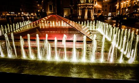 rynek: Fountain at main square called Rynek Glowny at city Krakow in Krakow Stock Photo