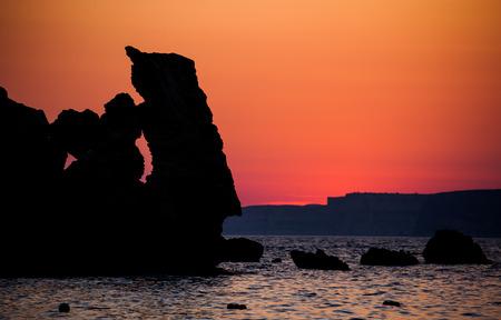 paradise bay: Sunset in Malta Stock Photo