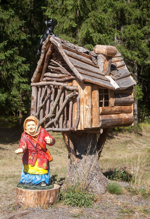 hag: Witch in front of house Stock Photo