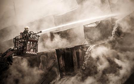 fireman: Fireman and burnt roof