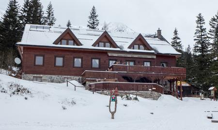 tatras tatry: ZIARSKA DOLINA, SLOVAKIA - FEBRUARY 6: Cottage Ziarska chata in West Tatras on February 6, 2016 in ZIarska dolina