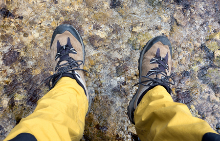 hiking shoes: Hiking shoes and river  - detail