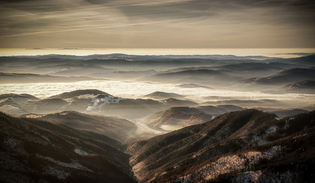inversion: Mountain panorama - inversion and colorful sky in Low Tatras, Slovakia Stock Photo