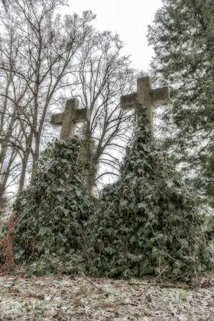 tumbas: Two scary tombs in graveyard Foto de archivo