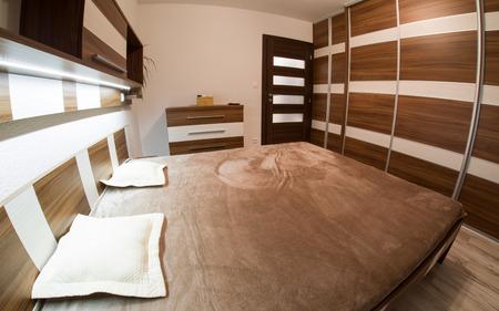 modern bedroom: Modern designed brown furniture in bedroom
