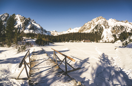 Snowy frozen lake Popradske pleso in winter High Tatras mountains, Slovakia