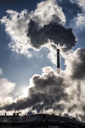 ruzomberok: Smoking chimneys and shinning sun in factory Mondi, Ruzomberok - Slovakia. Air pollution