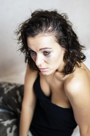tearful: Crying girl with tears and smudged make up on eyes Stock Photo