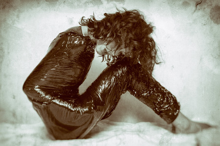 confined: Pretty face woman confined in black foil Stock Photo