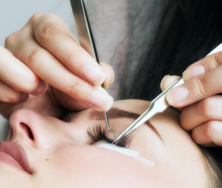 Artificial 4D lashes. eyelash extension procedure Stock Photo