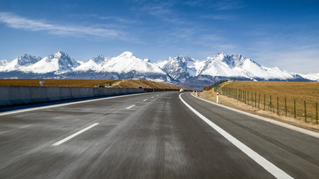 d1: Car on highway D1 and snowy peaks of High Tatras mountains, Slovakia