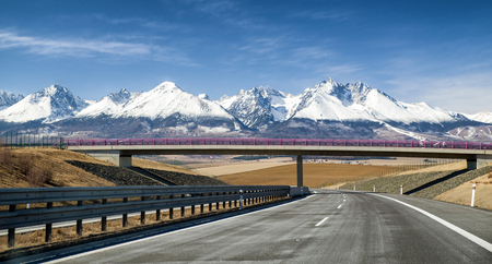 d1: Empty highway D1 and snowy peaks of High Tatras mountains, Slovakia