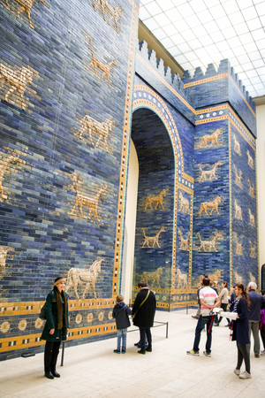 BERLIN, GERMANY - APRIL 7: Tourists in front of Ishtar gate from historical town Babylon gate in Pergamon museum on April 7, 2017 in Berlin