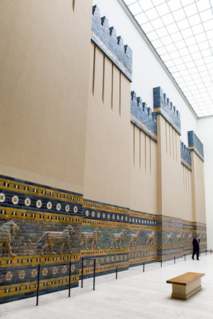 ishtar: BERLIN, GERMANY - APRIL 7: Tourists in front of Ishtar gate from historical town Babylon gate in Pergamon museum on April 7, 2017 in Berlin