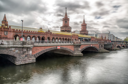 BERLIN, GERMANY - APRIL 8: YYellow train on Oberbaum bridge on April 8, 2017 in Berlin