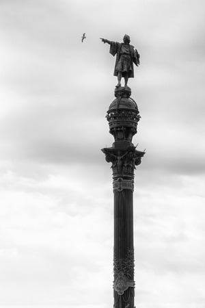 Christhoper Columbus monument in La Rambla. Barcelona, Spain showing on seagull. Black and white photo.