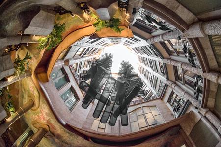 Atrium of Casa Mila also known La Pedrera -  house designed by Antoni Gaudi in Barcelona, Spain Stock Photo