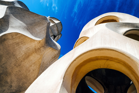 Chimney on rooftop of Casa Mila - house designed by Antoni Gaudi in Barcelona, Spain
