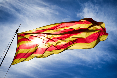 Waving Catalonia flag and blue sky Reklamní fotografie