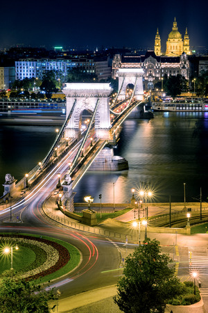 light chains: Famous Chain bridge, Stephens  basilica at night and river Danube in Budapest Stock Photo