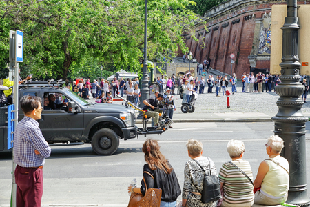 film crew: BUDAPEST, HUNGARY - MAY 6: Cameraman filming Hong Kong movie on May 6, 2017 in Budapest Editorial